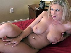 Horny blonde milf likes to slide her soft feet over a huge dick