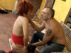 Hot blooded red-haired grandma in steamy red lingerie and stockings still has got something to show us. She stands on her knees in front of horny daddy while he caresses her ruined cunt before he dildo fucks it.