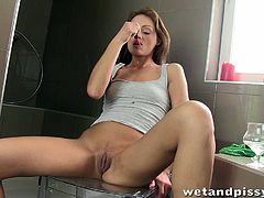 sexy woman plays with her piss
