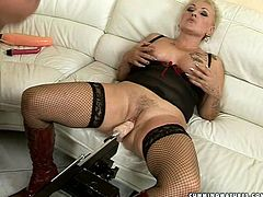 Skanky short haired blond mom in seductive black lingerie and fishnet stockings sits on the couch with legs spread wide while getting her ruined pussy fucked with dildo machine in peppering sex video by 21 Sextury.