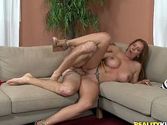 Ugly but buxom red haired milf gets her wet cunt fucked missionary on sofa