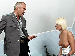 Perverse grey-haired daddy hooks up a salty blond whore in the street. He lures her home where she gets naked before going down on her knees to suck his penis zealously.