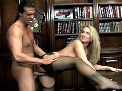 Hot tempered patron drills his busty and sexy blond secretary right on the table. He rips her pantyhose up and penetrates her juicy slit.
