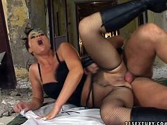 Voracious bitches are fucking hard in provocative FFM threesome. Torn mistress in fishnet stocking is drilled in her ass hole by brutish stud. Then, blonde sub inserts big dildo in her mistress' vaginal opening so she is double penetrated. Closer to the end of the session, blonde chick gets fat cumshot in her mouth so the cream is dripping down her chin.