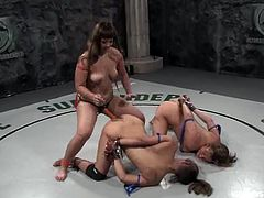 These four chicks are divided into two teams, orange and blue. The orange team wins, so girls from blue team get fucked with a strap-on by girls from orange team.