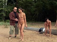 These three slaves listen to their master when he tells them what to do. They are naked on the beach, doing weird exercises.