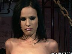 Fixed with chains brunette gets her pussy polished with a candle in dark room
