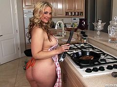 Blonde busty and good in the kitchen, Sarah is the perfect wife. She's not only a caring woman that makes sure her guy has everything he needs, this hot mom is amazing when it's about fucking too. She sucks his dick in the shower, on the couch and even when he's eating. Now that's a real wife!