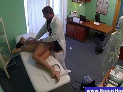 Brunette patient fucked by doctors cock during an examination