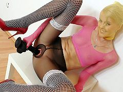 Adorable blonde is very nasty and in need to pose while masturbating in pantyhose solo