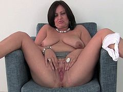This sexy mom wants to share busty body with us,Watch her mouth watering boobs,She lowers her panties and sheer pantyhose to give her mature wet pussy some pleasure.Don't miss it!