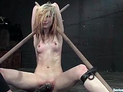 Slim blonde Calico is having fun with some guy in a basement. She lets the dude tie her up and then the man rubs her nice pussy with a vibrator.