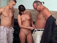 Hussy hade with perky small tits sucks two cocks one by one. When two men cum they glaze her face with jizz. They also are pissing on her face. Wicked porn clip presented by 21 Sextury.