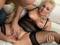 Whorish short haired blond mature in raunchy black lingerie and fishnet stockings lies on her back with legs wide open while a perverse daddy drills her soaking shaved cunt with a dildo and later stretches with gynecological speculum.