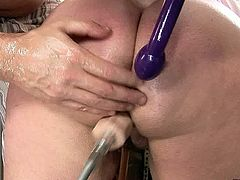 Immense overaged blond BBW stands in doggy pose while a perverse dad pokes her puffy vagina with a dildo machine before he starts risting her stretched anal hole in perverse sex clip by 21 Sextury.