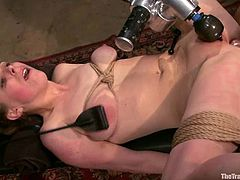 This horny sex slave gets her legs wide open for a water pleasures. Then babe gets tied up in the device and her master makes her reach orgasm with some toys!