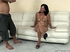 Perverse young dude is a fan of sextractive moms. This time he makes out with a skanky brunette mature. He forces her lie on the white couch with legs spread aside to finger her soaking vagina.