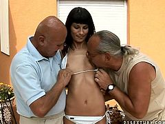 Whorish brunette MILF is ready to fuck with two aroused daddies for 50 bucks. She lies on her back giving a blowjob to mini cock while bald dad tongue fucks her soaking pussy in MMF sex orgy by 21 Sextury.