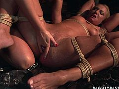 Blonde whore gets her whole body tied up with ropes in this wild BDSM scene. Cruel mistress knows how to make punishment more effective. She shoves her whole fist deep inside her slave's tight pussy and starts pumping it in and out.