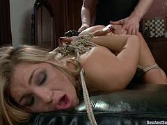 Adorable blonde chick takes her nightie off and gets fingered. Later on she gets tied up and whipped. Then she gets her pussy fucked and ass toyed.