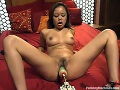 Petite Latine Annie Cruz is having fun with a fucking machine in a bedroom. She rubs her snatch and then gets it stunningly pounded by a the fucking machine.