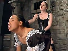 Naughty chick in classic mistress outfit whips a guy and then dresses him in female housemaid dress. After that she toys his ass with a strap-on.
