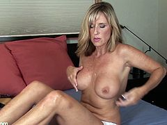A horny-ass fucking blonde woman rubs her pink-ass mature pussy till she gets all wet for the camera, hit play and check it out!