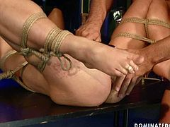 This dude knows how to make punishment more effective. He binds his slave in ropes and spanks her snatch with a leather paddle. Then he clamps clothespins on slave's pussy. This BDSM video is worth checking out!