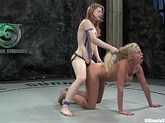 Two hot bitches wrestle naked and the winner gets to sex up the loser, hit play and check it out right here, it's fucking hot!