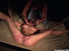 Spoiled bosomy slut gets bandaged and her eyes blindfolded as she lies crucified in front of aroused wanker who slaps her body with lash in BDSM-styled sex video by 21 Sextury.
