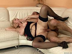 Sex-starved blondie in sexy black stockings is the kind of woman that needs to be fucked hard. Horny stud pounds her twat mercilessly in sideways position making her beg for beg more.