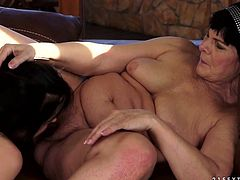 Cougar brunette pleases young body of one tasty looking lesbian. Sweetie dives between legs in her hairy muff and later sucks her saggy tits.