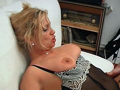 See a wild blonde mature wearing black stockings while her pussy and ass get spectacularly banged into a breathtaking explosion of pleasure.