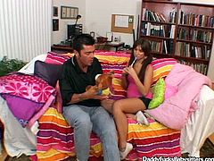 Playful brunette amateur hooks up with her dad's bestie. They sit on her bed chatting before she lies with legs pulled up allowing him stroke her vagina through panties.