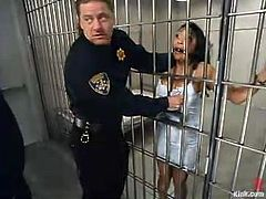 Mika Tan is the hot Asian inmate getting a hardcore domination and bondage fuck by two police officers in jail.