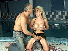 Big breasted blonde whore rides the sybian machine passionately as if her life depends on it. Make your ass comfortable in your seat and enjoy the action.