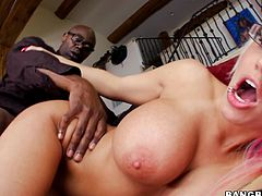 Watch this busty blonde getting the monster cock treatment where she takes on this brother's black anaconda until she ends up with her face covered by his cum.
