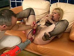 Dirty whore with hairy snatch deserves proper pounding. She spreads her legs wide to let her horny friend drill her soaking pussy with fucking machine.