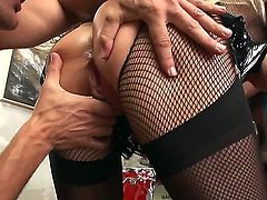Turned on and slutty golden haired honey Helena White with big boobs and shaved taco in her fishnet stockings enjoys in getting rammed hard in a hot threesome while giving head