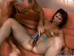 Dirty mom with hairy pussy is wearing fishnet pantyhose and high heel shoes. She has got a huge hole in her pantyhose between her legs so the guy has an ease access to her clam. He drills wet vagina with huge dildo pushing it deep. Then he fucks dirty mommy is doggy style sex position.