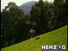 Check out this scene from a vintage german porn movie. Young blonde slut shows her natural tits outdoors on the field!