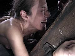 Curvaceous Jade Marxxx gets gagged and then tied up with straps. After that she gets her ass spanked and pussy toyed deep with different dildos.