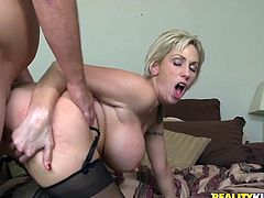 Busty blonde milf Kasey Grant licks and rubs her man's dick and takes it into her throbbing cooch. They have fervent sex in cowgirl and missionary positions and Kasey moans loudly with pleasure.