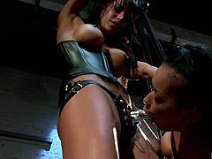 This extreme bondage video has Gia Dimarco banging Skin Diamond's pussy with a strapon while she's strapped hanging ceiling the ground.