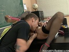 Sex hungry blond teacher seduces her student after classes are over. She lies on the desk while he tongue fucks her bald vagina with eyes closed. Later she kneels down to give him a blowjob.