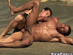 These two Latin gays are on the beach and taking advantage of the sea air for some hot cock sucking and bareback ass fucking in the middle of the day.