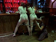 The BDSM action goes on in the bar and the lesbian dominant vixen will have fun with two chubby girls by torturing and strapon fucking them.