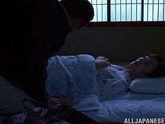 Sleeping Japanese chick gets tied up with ropes. So, she wakes up but cannot do anything. She gets her tits licked and pussy fucked hard.