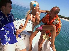 Two studs lure this horny babe on the boat and then seal away from the coast. They they turn the engine off and make this honey feel so fucking good.