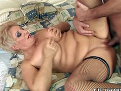 Immense blond mature BBW gets her pussy impaled doggy style by young insatiable fucker before she lies on her back for a fuck in missionary style. Later she pleases him with tit fuck in steamy sex video by 21 Sextury.